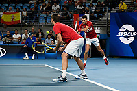 12th January 2020; Sydney Olympic Park Tennis Centre, Sydney, New South Wales, Australia; ATP Cup Australia, Sydney, Day 10; Serbia versus Spain;Novak Djokovic of Serbia plays a backhand as Viktor Troicki of Serbia watches on in their doubles rubber against Team Spain - Editorial Use