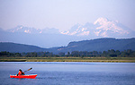 Pacific Northwest, Mount Baker, Woman sea kayaker, Skagit Bay, Skagit River estuary, Puget Sound, Washington State, USA, Sarah Shannon,