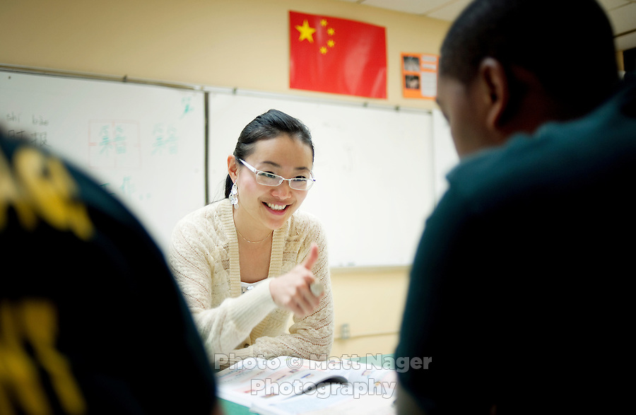 "Yue Zheng, (cq) a Chinese english teacher who has been teaching at Macarthur High School, gives an approving thumbs up to senior Raymond Veal (cq) during a Chinese 2 class in Lawton, Oklahoma, April 29, 2010.  Zheng is teaching in the US as part of a ""guest teacher"" program for two years and will soon be returning to her home in Henan province in China...PHOTO/ MATT NAGER"