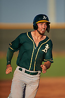 AZL Athletics Green Gavin Jones (12) runs to third base during an Arizona League game against the AZL Reds on July 21, 2019 at the Cincinnati Reds Spring Training Complex in Goodyear, Arizona. The AZL Reds defeated the AZL Athletics Green 8-6. (Zachary Lucy/Four Seam Images)