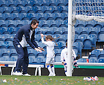 Neil Alexander bids farewell to Ibrox as he has one last kick about with his girls on the park after the game