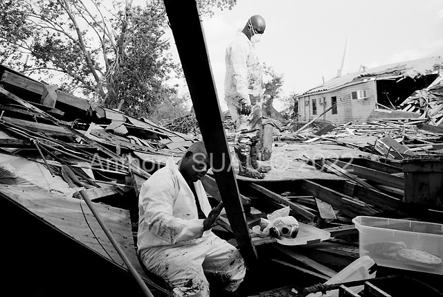 New Orleans, Louisiana<br /> December 3, 2005 <br /> <br /> Rosiland Barnett and her relative S.J.Thomas, 71 find a items in their house that is house is covered in thick mud and debris after hurricane Katrina struck breaking the levee's and flooding the district.