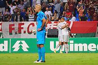 ATENÇÃO EDITOR: FOTO EMBARGADA PARA VEÍCULOS INTERNACIONAIS. - RIO DE JANEIRO, RJ, 06 DE SETEMBRO DE 2012 - CAMPEONATO BRASILEIRO - FLUMINENSE X SANTOS - Samuel, jogador do Fluminense, comemora o seu gol com Thiago Neves, enquanto Bruno Rodrigo lamenta, durante partida contra o Santos, pela 22a rodada do Campeonato Brasileiro, no Stadium Rio (Engenhao), na cidade do Rio de Janeiro, nesta quarta, 06. FOTO BRUNO TURANO BRAZIL PHOTO PRESS