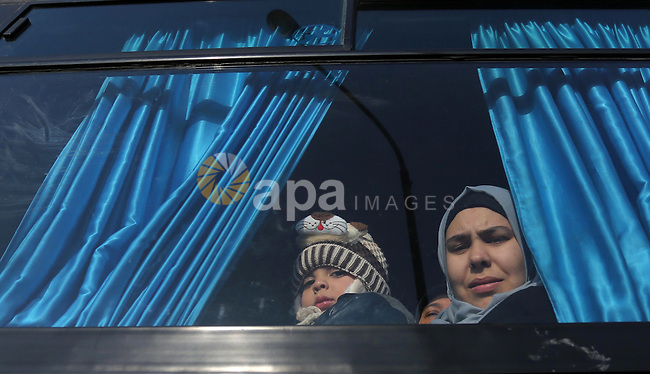 Palestinians sit in a bus as they wait for travel permits to cross into Egypt through the Rafah border crossing after it was opened by Egyptian authorities for humanitarian cases, in Rafah in the southern Gaza Strip on February 11, 2017. Photo by Ashraf Amra