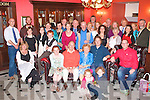 DOUBLE CELEBRATION: Ciaran and Marie O'Connell, Leeside, Oakpark, Tralee (seated centre) enjoying a great time celebrating their 45th wedding anniversary and also Ciaran 70th birthday with a large group of family and friends at the Imperial hotel, Tralee on Saturday.