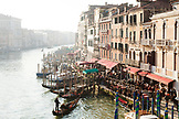 ITALY, Venice. View of the Grand Canal, homes and restaurants from the Rialto Bridge.