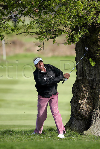 12 May 2005: Northern Irish golfer Darren Clarke looks into the distance after playing on iron shot out from under a tree during the first round of the The Daily Telegraph Dunlop Masters played at the Forest of Arden, Warwickshire. Photo: Neil Tingle/Action Plus..050512 golf golfer