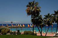 Flags flying over Playa de Los Amadores, Puerto Rico, Gran Canaria,Canary Islands, Spain