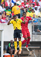 PHILADELPHIA, PA - JUNE 30: Leon Bailey #7 and Michael Murillo #23 go up for a header during a game between Panama and Jamaica at Lincoln Financial Field on June 30, 2019 in Philadelphia, Pennsylvania.