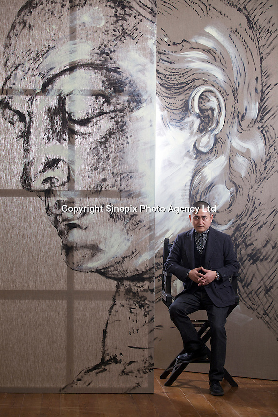 "Zeng Fanzhi, China's renowned contemporary artist, poses for pictures between an unfinished painting in his Beijing studio on 9th November, 2012, China. Zeng gained the title of ""Number One"" Chinese artist in terms of auction price in 2009.<br /> <br /> PHOTO BY RICKY WONG / SINOPIX"