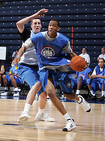WF Tevin Baskin (Stamford, CT / Trinity Catholic) drives the ball during the NBA Top 100 Camp held Thursday June 21, 2007 at the John Paul Jones arena in Charlottesville, Va. (Photo/Andrew Shurtleff)