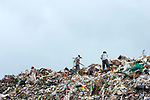 Burmese refugees and migrants work in rubbish dump site in the outskirts of the border town of Mae Sot, Thailand August 16 2017.