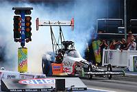 Jun 19, 2015; Bristol, TN, USA; NHRA top fuel driver Clay Millican during qualifying for the Thunder Valley Nationals at Bristol Dragway. Mandatory Credit: Mark J. Rebilas-