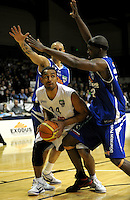 Giants forward Mika Vukona looks for a way round Lindsay Tait and Kareem Johnson (right). NBL - Wellington Saints v Nelson Giants at TSB Bank Arena, Wellington, New Zealand on Thursday, 19 May 2011. Photo: Dave Lintott / lintottphoto.co.nz
