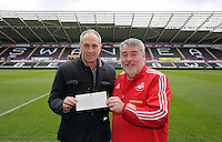 Head coach Francesco Guidolin presents a SwansAid cheque to a club representative at the Liberty Stadium, Swansea, Wales, UK. Thursday 07 April 2016