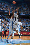 Brandon Childress (0) of the Wake Forest Demon Deacons floats a shot over Cameron Johnson (13) of the North Carolina Tar Heels during first half action at the Dean Smith Center on December 30, 2017 in Chapel Hill, North Carolina.  The Tar Heels defeated the Demon Deacons 73-69.  (Brian Westerholt/Sports On Film)
