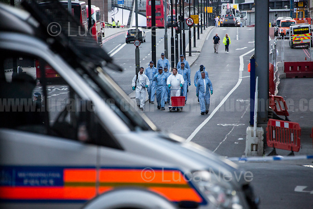 Forensic Police. <br /> <br /> London Bridge.<br /> <br /> London, 04/06/2017. Documenting the day after the tragic terrorist London Bridge &amp; Borough Market Attack of the 03 June 2017.<br /> <br /> Yesterday, 3 June 2017, at around 21:58, a terrorist attack took place in London Bridge &amp; Borough Market, London. The attack began when a white van mounted the pavement and run into pedestrians from the north side of London Bridge. Then, the van stopped on the south of the bridge and the three men, wielding knives and wearing fake explosive vests, ran to Borough Market, where they stabbed people inside restaurants. Ten people (including three attackers) were killed and 48 injured in the attack. Three suspects were shot dead by police.<br /> <br /> For more information please click here: https://en.wikipedia.org/wiki/June_2017_London_attack &amp; http://www.bbc.co.uk/news/live/uk-40147014