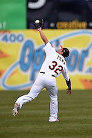 Frederick Keys second baseman Jerome Pena (32) catches a shallow fly ball over his shoulder during a game against the Carolina Mudcats on April 26, 2014 at Harry Grove Stadium in Frederick, Maryland.  Carolina defeated Frederick 4-2.  (Mike Janes/Four Seam Images)