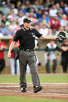 Umpire Brandin Sheeler signals fair ball during a game between the South Bend Cubs and Dayton Dragons on May 11, 2016 at Fifth Third Field in Dayton, Ohio.  South Bend defeated Dayton 2-0.  (Mike Janes/Four Seam Images)