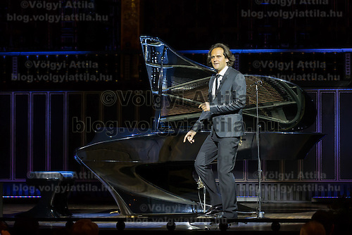 Gergely Boganyi of Hungary pianist and designer approaches the newly introduced piano during a Day of Hungarian Culture celebration in Budapest, Hungary on January 21, 2015. ATTILA VOLGYI
