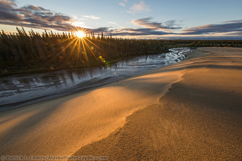 Sunset over the Ahnewetut Creek which flows through the Great Sand Dunes in the Kobuk Valley National Park, Arctic, Alaska.