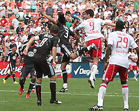 Juan Manuel Pena #3 of D.C. United misses the ball and allows Juan Pablo Angel #9 of the New York Red Bulls to score on this play during an MLS match on May 1 2010, at RFK Stadium in Washington D.C.