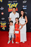 "LOS ANGELES, USA. June 12, 2019: Mario Lopez, Courtney Laine Mazza, Dominic Lopez & Gia Francesca Lopez at the world premiere of ""Toy Story 4"" at the El Capitan Theatre.<br /> Picture: Paul Smith/Featureflash"
