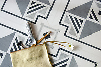 Jardin des Tuileries, a hand-cut mosaic, shown in polished Thassos, Bardiglio, and Carrara, is part of the Jardins Français™ collection by Caroline Beaupere for New Ravenna.