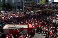 """Red Shirt"" protesters cheer as fire engines withdraw along with the military on Ploenchit road in Central Bangkok."