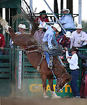 Bryce Miller competes in the saddle bronc riding event at the Reno Rodeo in Reno, Nev., on Friday, June 20, 2014.<br />