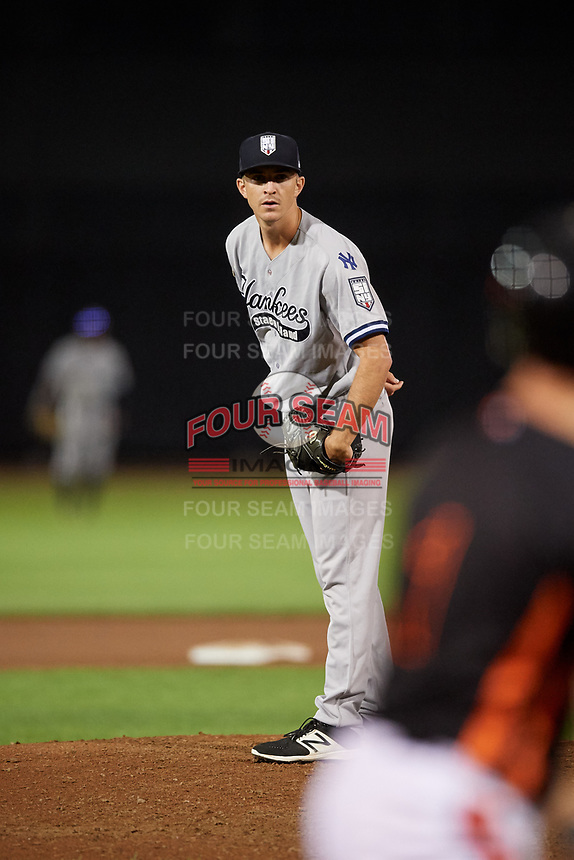 Staten Island Yankees relief pitcher Aaron McGarity (14) looks in for the sign during a game against the Aberdeen IronBirds on August 23, 2018 at Leidos Field at Ripken Stadium in Aberdeen, Maryland.  Aberdeen defeated Staten Island 6-2.  (Mike Janes/Four Seam Images)
