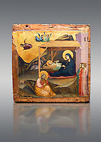 Gothic painted panel of the Nativity scene by Taddeo Gabbi of Florence, circa 1325, tempera and gold leaf on wood. National Museum of Catalan Art, Barcelona, Spain, inv no: MNAC 212807. <br /> Taddeo Gabbi, one of Giotto's most brilliant disciples, painted this Nativity when he was still part of Giotto's workshop. The painting has many of Giotto's hallmarks such as  spatial illusionism or the reality of figures that can be seen in the nativity of the Peruzzi Chapel.<br /> <br /> SPANISH<br /> <br /> Taddeo Gabbi, uno de los discipulos mas brillantes de Giotto, debio pintar esta Natividad cuando aun formaba parte del taller del maestro. En ella se ven las conquistas de la &quot;revolucion giottesca&quot;, como el illusioismo espacial o el realismo de las figuras. Maria arropa a Jesus dentro del establo, mientras los sobrevuela un grupo de angeles. La posicion de uno de ellos y la presencia de una oveja indican que la composicion se completaba a la izquierda con el Anuncio a los pastores. En primer termino aparecen un pensativo Jose y las dos parteras que susurran, un recurso ya utilizado pr Giotto en los frescos de la Capilla Peruzzi.