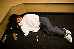 Lucha Libre AAA wrestler Jack Evans takes a nap before a match in San Jose, CA March 29, 2009.