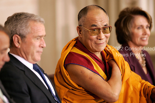The Dalai Lama sits between U.S. President George W. Bush and Speaker of the House Nancy Pelosi during a Congressional Gold Medal ceremony in the US Capitol in Washington DC USA on 17 October 2007.