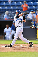 Asheville Tourists catcher Willie MacIver (23) swings at a pitch during game one of a double header against the Charleston RiverDogs at McCormick Field on April 9, 2019 in Asheville, North Carolina. The Tourists defeated the RiverDogs 17-3. (Tony Farlow/Four Seam Images)