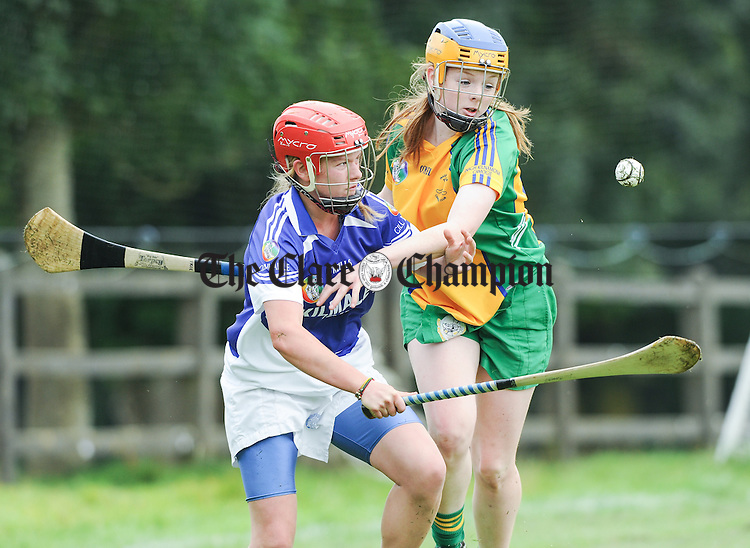 Sarah Reidy of Kilmaley, the eventual winners, in action against Amy Keating of Inagh-Kilnamona during their Senior Championship Cup semi-final at Ballyea earlier today. Photograph by John Kelly