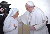 85-year-old sister Maria Concetta  the Pope Francis as he presents her with a Pro Ecclesia et Pontifice award during his weekly general audience, in St. Peter's Square, at the Vatican, Wednesday, March 27, 2019. 85-year-old sister Maria Concetta Esu is an obstetrician who gave birth to some 3,000 children during her 60 years of missions in Africa, that the pontiff met during his trip to the Central African Republic. Pope Francis during of a weekly general audience at St Peter's square in Vatican, Wednesday,March 27, 2019