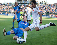 Sam Cronin (left) slide tackles Juan Manuel Pena (right). The San Jose Earthquakes tied DC United 1-1 at Buck Shaw Stadium in Santa Clara, California on July 3rd, 2010.