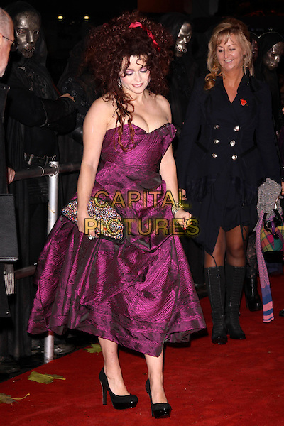 HELENA BONHAM CARTER.'Harry Potter And The Deathly Hallows: Part 1' world film premiere, Empire cinema Leicester Square and Odeon Leicester Square, London, England 11th November 2010 .full length strapless purple pink vivienne westwood ruched dress black platform shoes print fan clutch bag lulu guinness cleavage sparkly beaded.CAP/AH.©Adam Houghton/Capital Pictures.