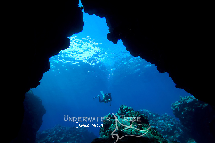 A diver with sunlight filtering through cavern system, Yap Caverns, Yap, Federated States of Micronesia, Pacific Ocean