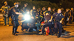 BATON ROUGE, LA -JULY 09: Baton Rogue police keep watch while others arrest protesters they've dragged from the crowd into the street on July 9, 2016 in Baton Rouge, Louisiana. Alton Sterling was shot by a police officer in front of the Triple S Food Mart in Baton Rouge on July 5th, leading the Department of Justice to open a civil rights investigation. (Photo by Mark Wallheiser/Getty Images)