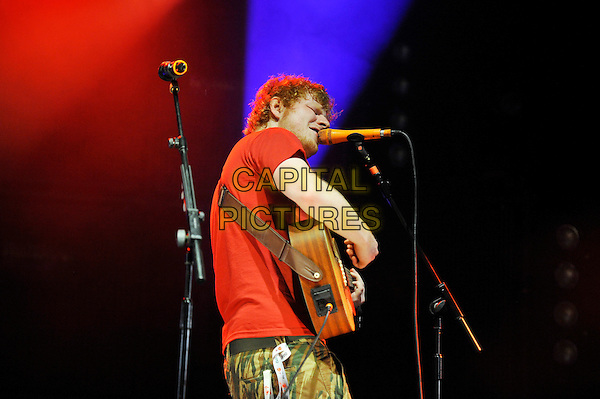 Ed Sheeran .performing at V Festival, Hylands Park, Chelmsford, Essex, England. .18th August 2012.on stage in concert live gig performance music half length red t-shirt tattoo singing guitar side profile .CAP/MAR.© Martin Harris/Capital Pictures.