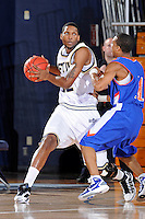 12 November 2010:  FIU's Brandon Moore (22) handles the ball in the first half as the FIU Golden Panthers defeated the Florida Memorial Lions, 89-73, at the U.S. Century Bank Arena in Miami, Florida.