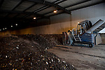Composted household waste is turned over  by a machine at  New Earth Solutions MBT plant, Wimbourne, Bournemouth.