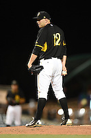 Bradenton Marauders pitcher Robby Rowland (12) looks for the sign during a game against the Jupiter Hammerheads on April 19, 2014 at McKechnie Field in Bradenton, Florida.  Bradenton defeated Jupiter 4-0.  (Mike Janes/Four Seam Images)