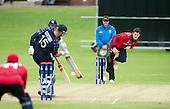 ICC World T20 Qualifier (Warm up match) - Scotland V Jersey at Heriots CC, Edinburgh - Jersey bowler Anthony Kay bowls past Umpire Ian Ramage — credit @ICC/Donald MacLeod - 06.7.15 - 07702 319 738 -clanmacleod@btinternet.com - www.donald-macleod.com