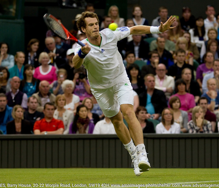 ANDY MURRAY (GBR) (4) against DANIEL GIMENO-TRAVERS (ESP) in the first round of the Gentlemen's Singles. Andy Murray beat Daniel Gimeno-Travers 4-6 6-3 6-0 6-0..Tennis - Grand Slam - Wimbledon - AELTC - London- Day 1 - Mon June 20th 2011..© AMN Images, Barry House, 20-22 Worple Road, London, SW19 4DH, UK..+44 208 947 0100.www.amnimages.photoshelter.com.www.advantagemedianetwork.com.