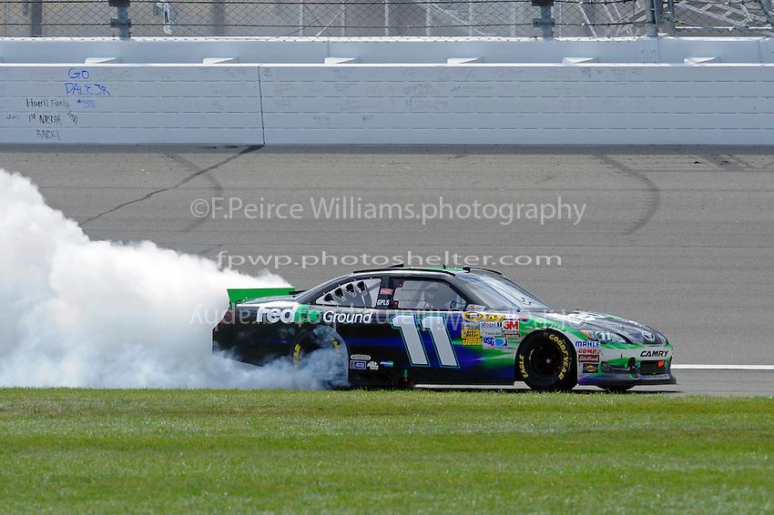 Winner Denny Hamlin, (#11) FedEx Ground Camry, does the burnout.