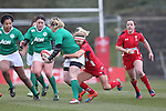 Wales centre Adi Taviner tackles Ireland fullback Niamh Briggs.<br /> 6 Nations Championship<br /> Wales v Ireland Women<br /> St Helens Swansea<br /> 15.03.15<br /> ©Steve Pope - SPORTINGWALES