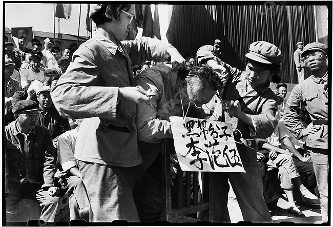 Accused of bearing a resemblance to Mao, Heilongjiang province Governor Li Fanwu's hair is brutally shaved and torn by zealous young Red Guards in Red Guard Square. Harbin, 12 September 1966